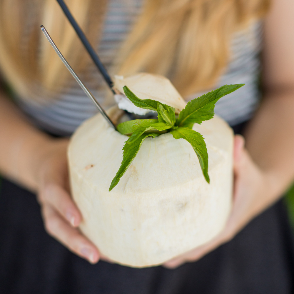 vans pina colada - served in a whole young coconut