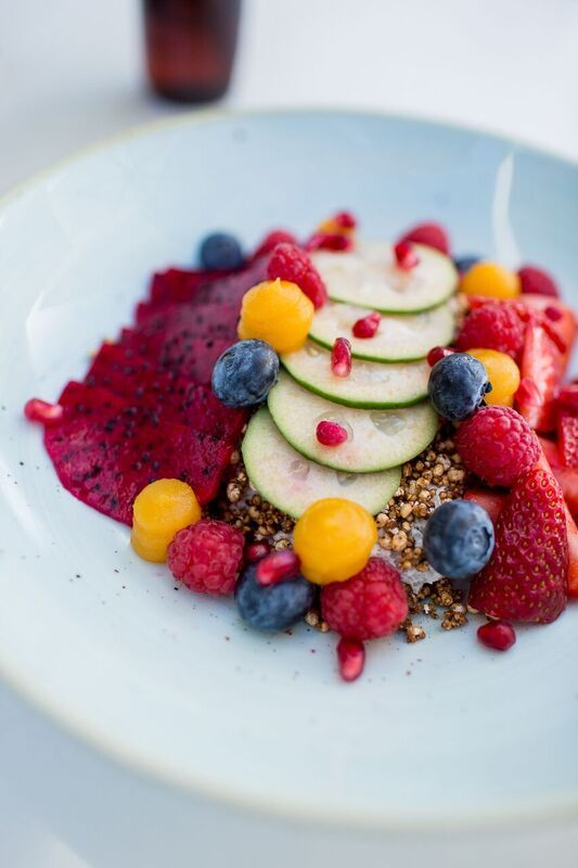 fruit nourish bowl - coconut chia rice pudding, dragon fruit, berries, pomegranate, puffed grain granola
