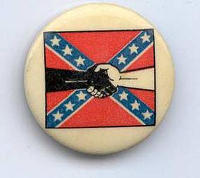 La bandera sureña y los brazos negro y blanco entrecruzados, símbolo de la alianza entre los Jóvenes Patriotas y los Panteras Negras