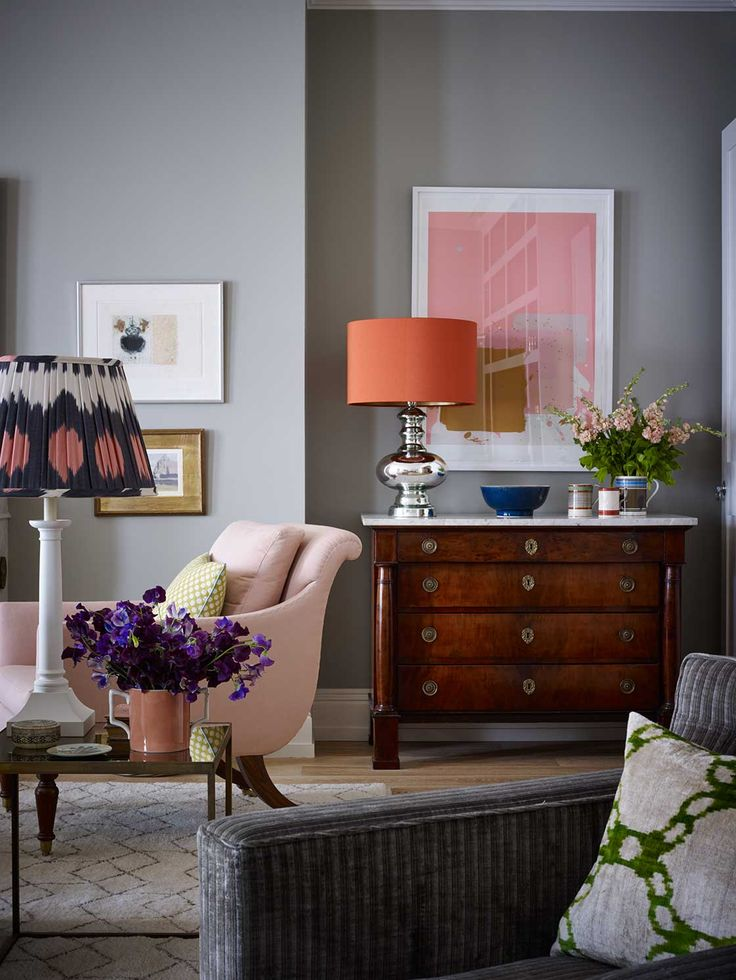 Sitting room designed by Ben Pentreath (benpentreath.cpm): neutral walls with bright cushions, lampshade and artwork to bring in colour