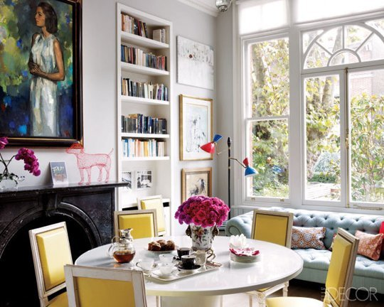 Christine D'Ornano's home in Elle Decoration: colourful chairs, art and accessories lift neutral backdrop