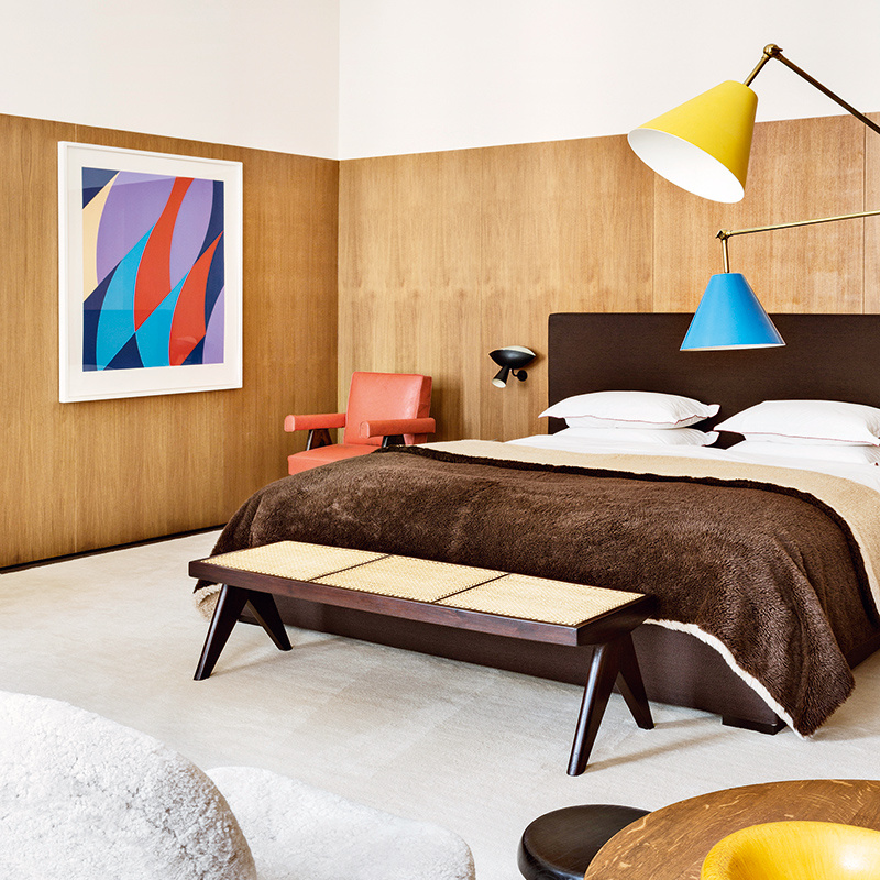 The bedroom in fashion boutique owner Emmanuel de Bayser's apartment, with Bridget Riley art on the wall. Photo:  Manolo Yllera