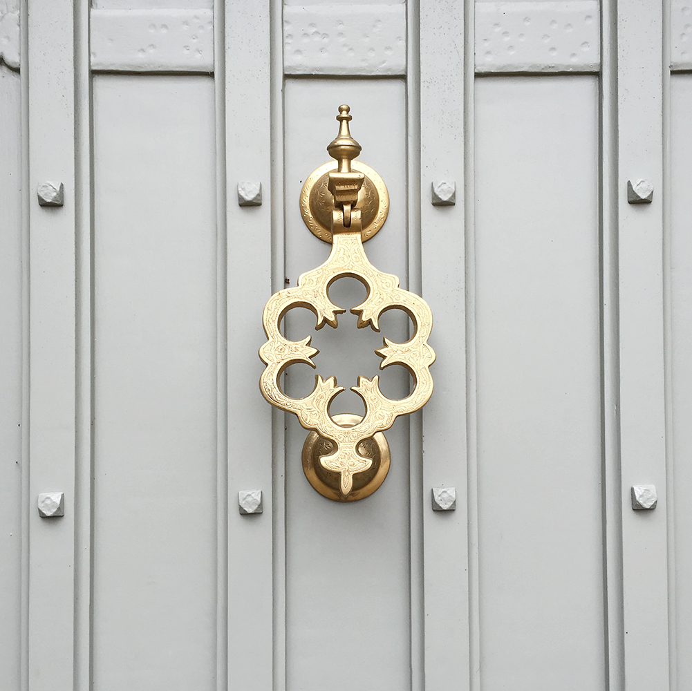 The front door, painted in F&B Pigeon with a Moroccan knocker