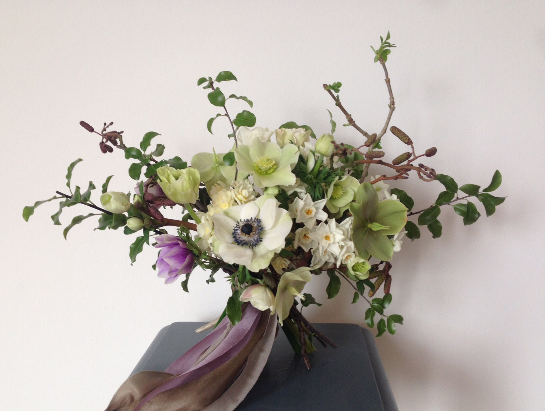 This British-grown bouquet includes anemone, hellebore, alder and paperwhite narcissi
