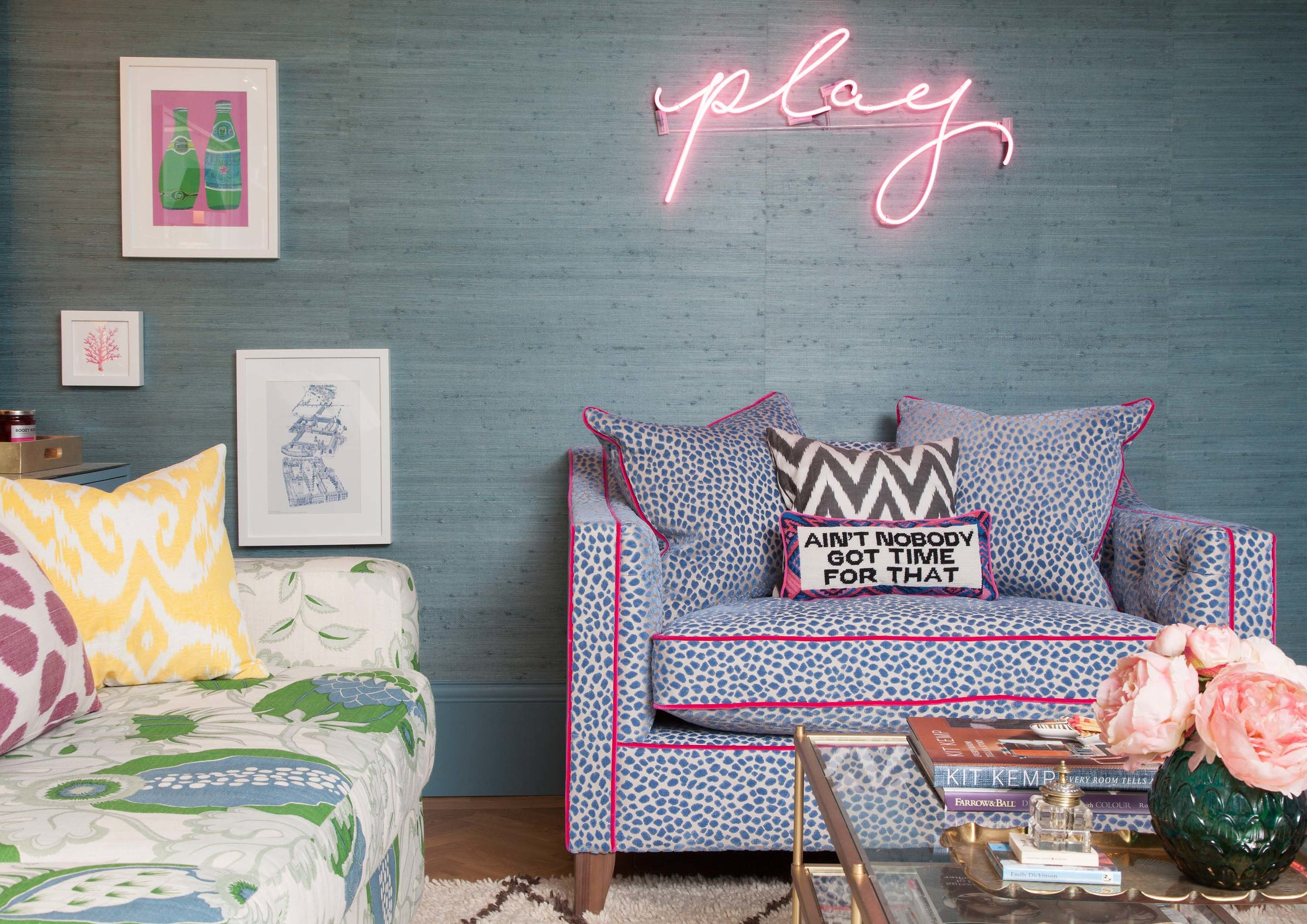 Phillip Jeffries teal grasscloth, pink neon sign, West Elm table