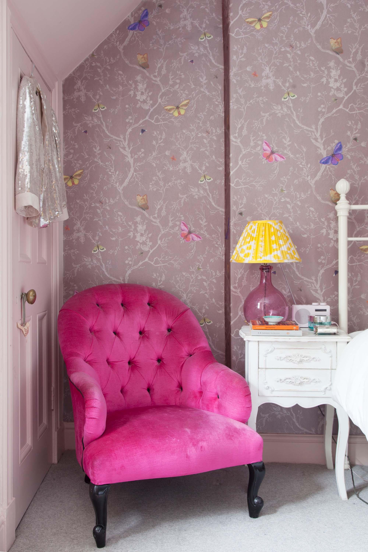 Hot pink velvet armchair Tann Rokka