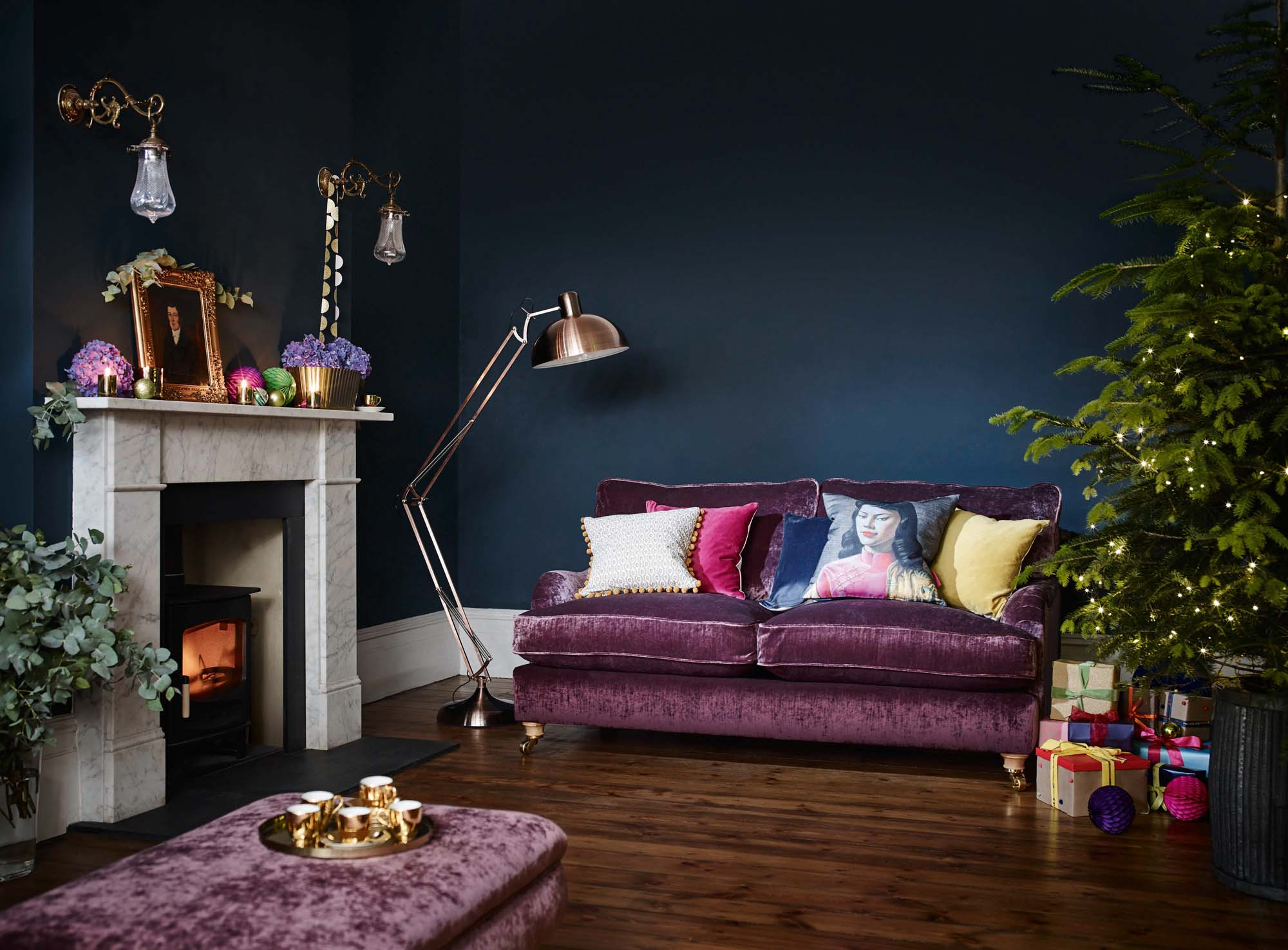 DFS purple sofa and blue walls with Christmas decorations