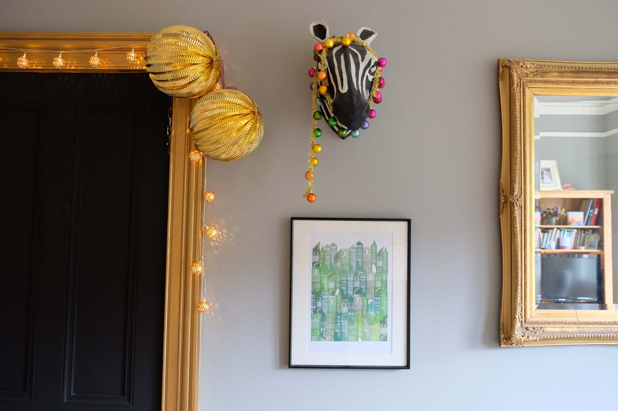 Rainbow garland on zebra and big gold ball decorations (what's wrong with me - why is that funny?): Rockett St George/Zebra: Anthropologie