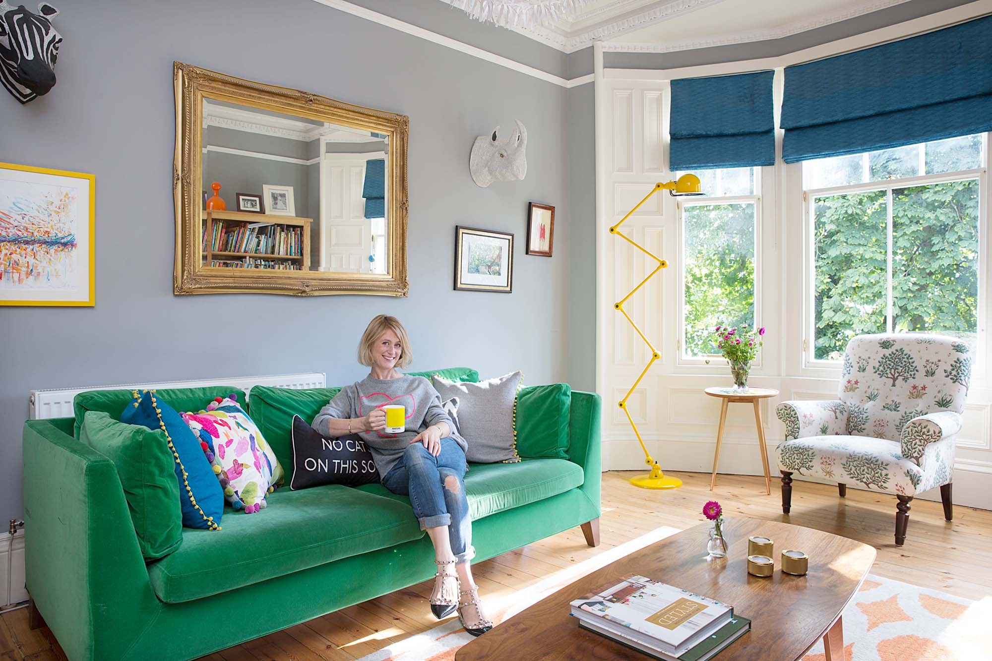 Prepping for a Little Yellow Couch podcast on a Big Green Sofa/Photo: Katie Lee
