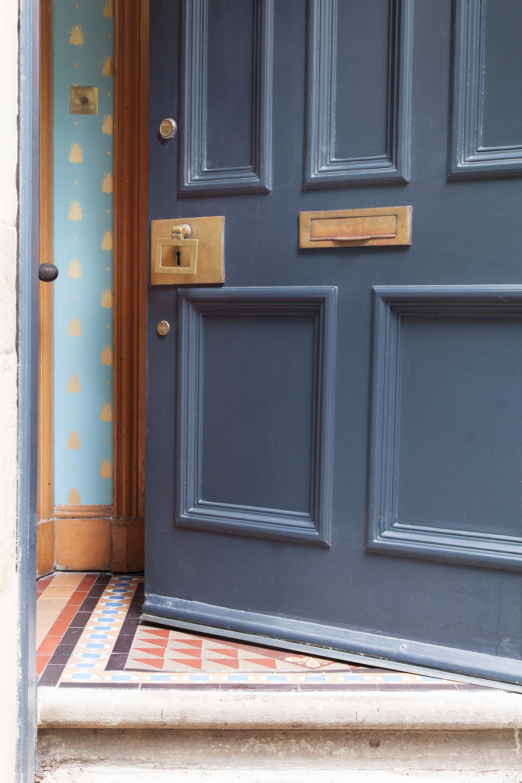 Farrow & Ball Railings front door with Bumblebee wallpaper