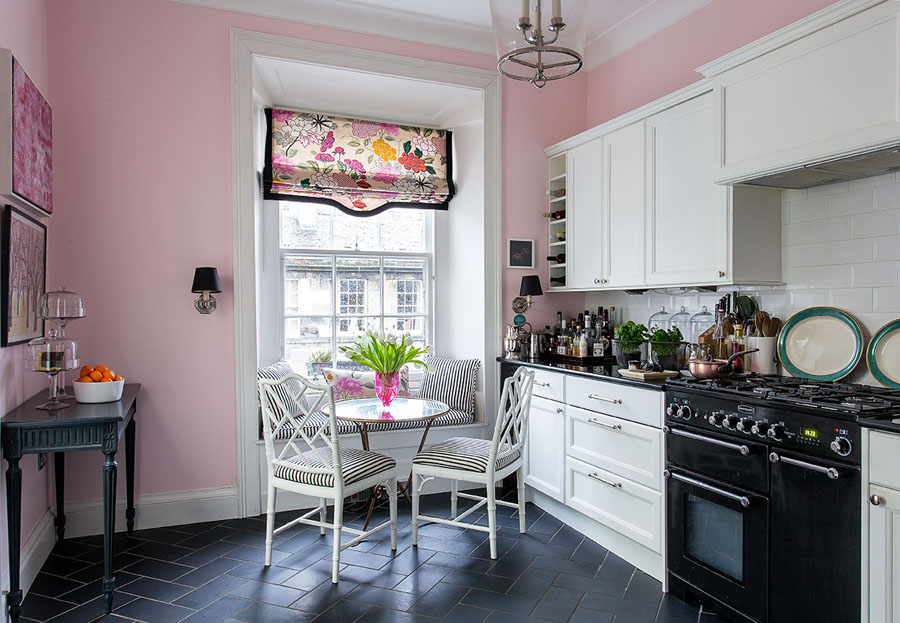 The wall colour is very similar to Farrow & Ball's Middleton Pink