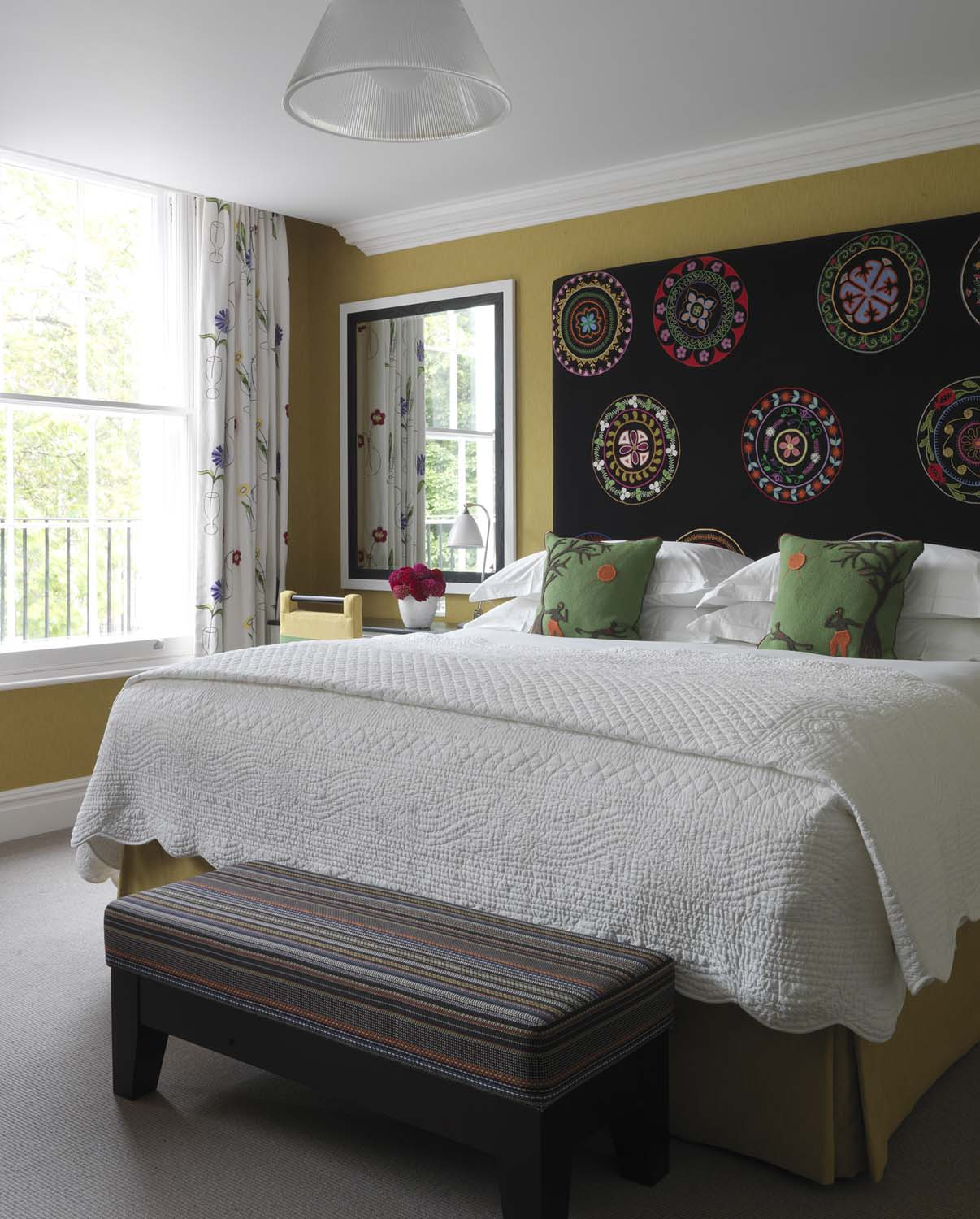 The Dorset Square room designed by Kit Kemp with embroidered headboard
