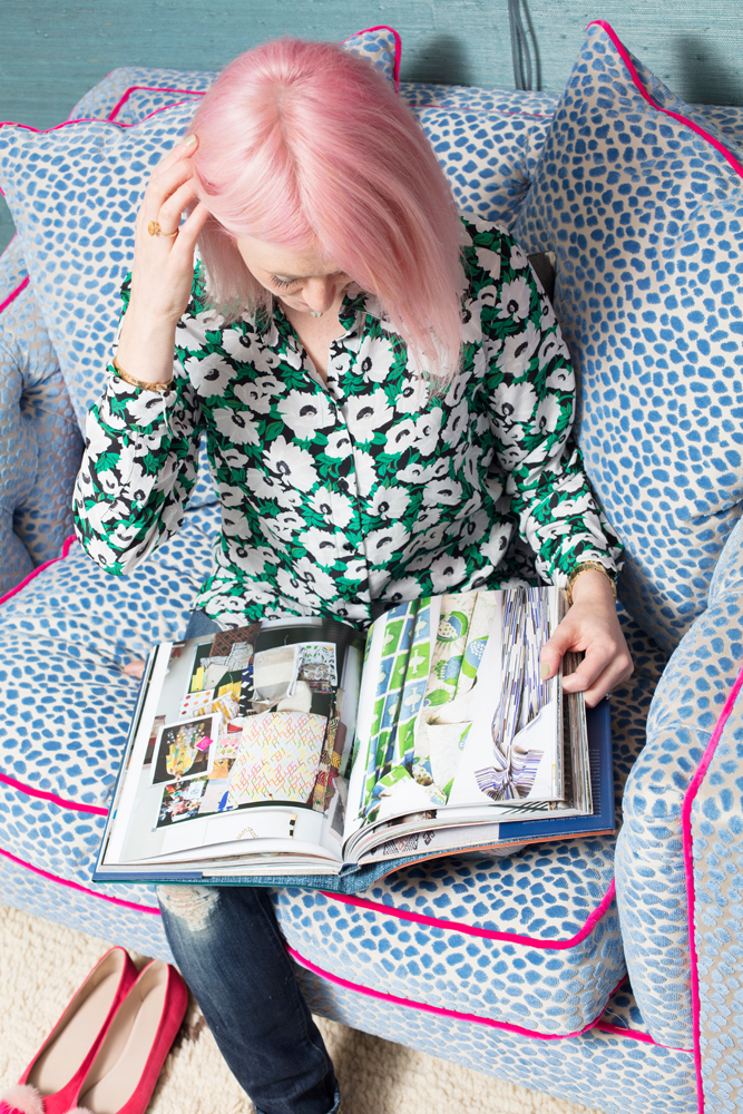 Reading Kit Kemp's Every Room Tells A Story wearing my Bicester haul/Photo: Susie Lowe