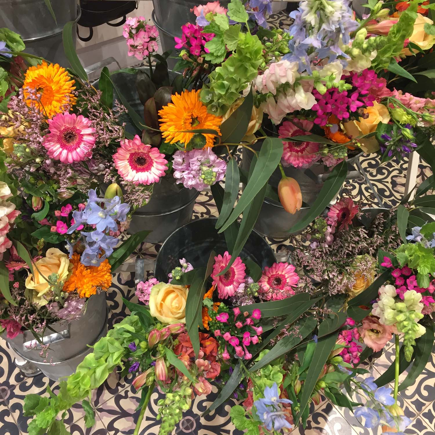 Flowers ready to be arranged at the workshop