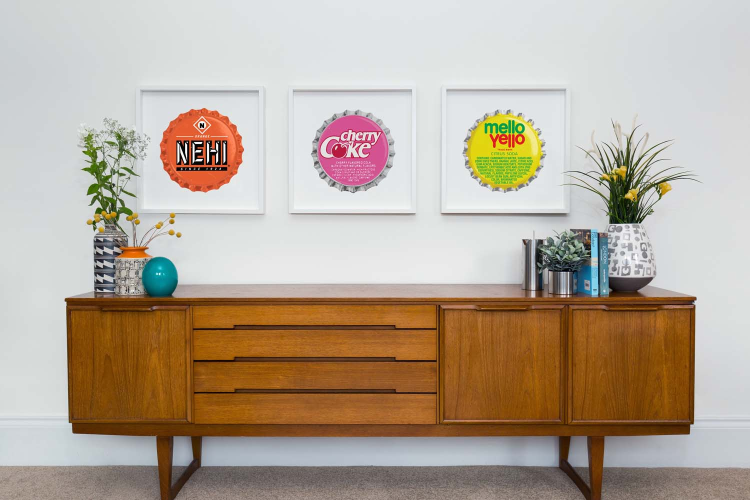 A sideboard with a selection of Go Pop prints