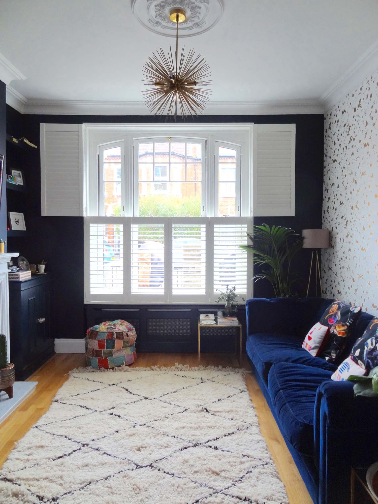 """Jess's living room: """"he doesn't get my thing for Moroccan rugs at all"""""""