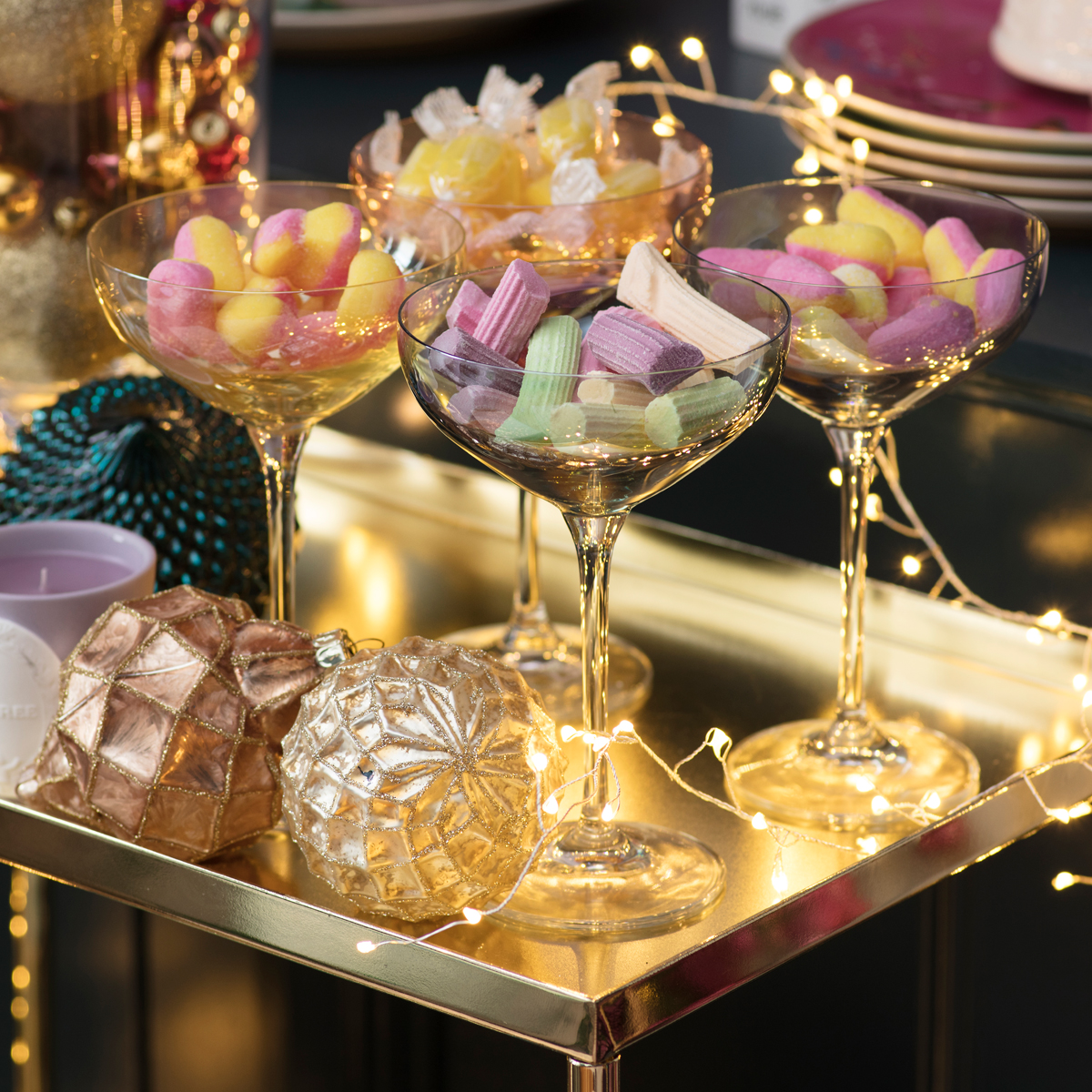 Retro sweets in champagne coupes and Laduree candles for a very sweet Christmas