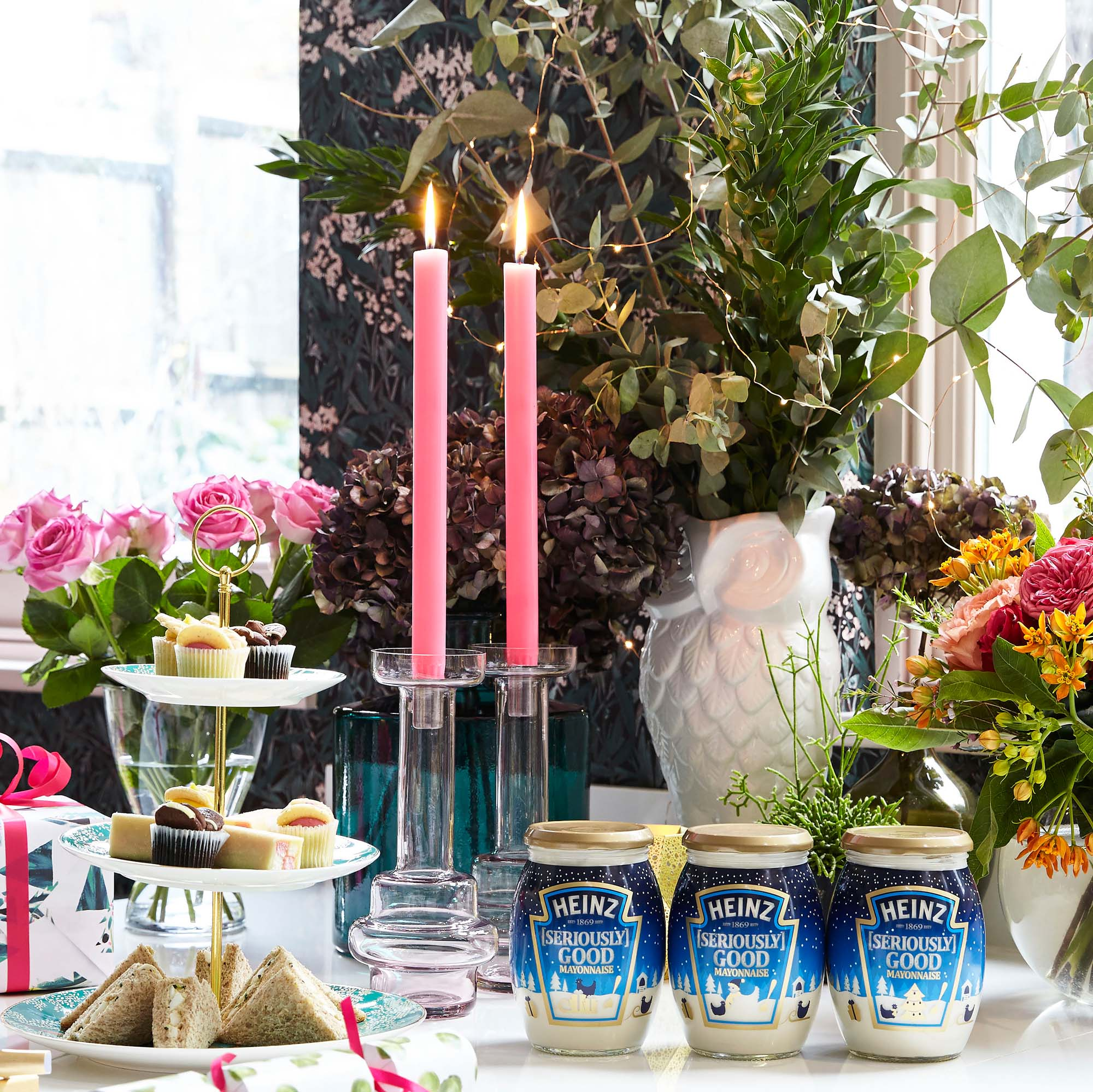 pink candles and flowers on the Christmas table