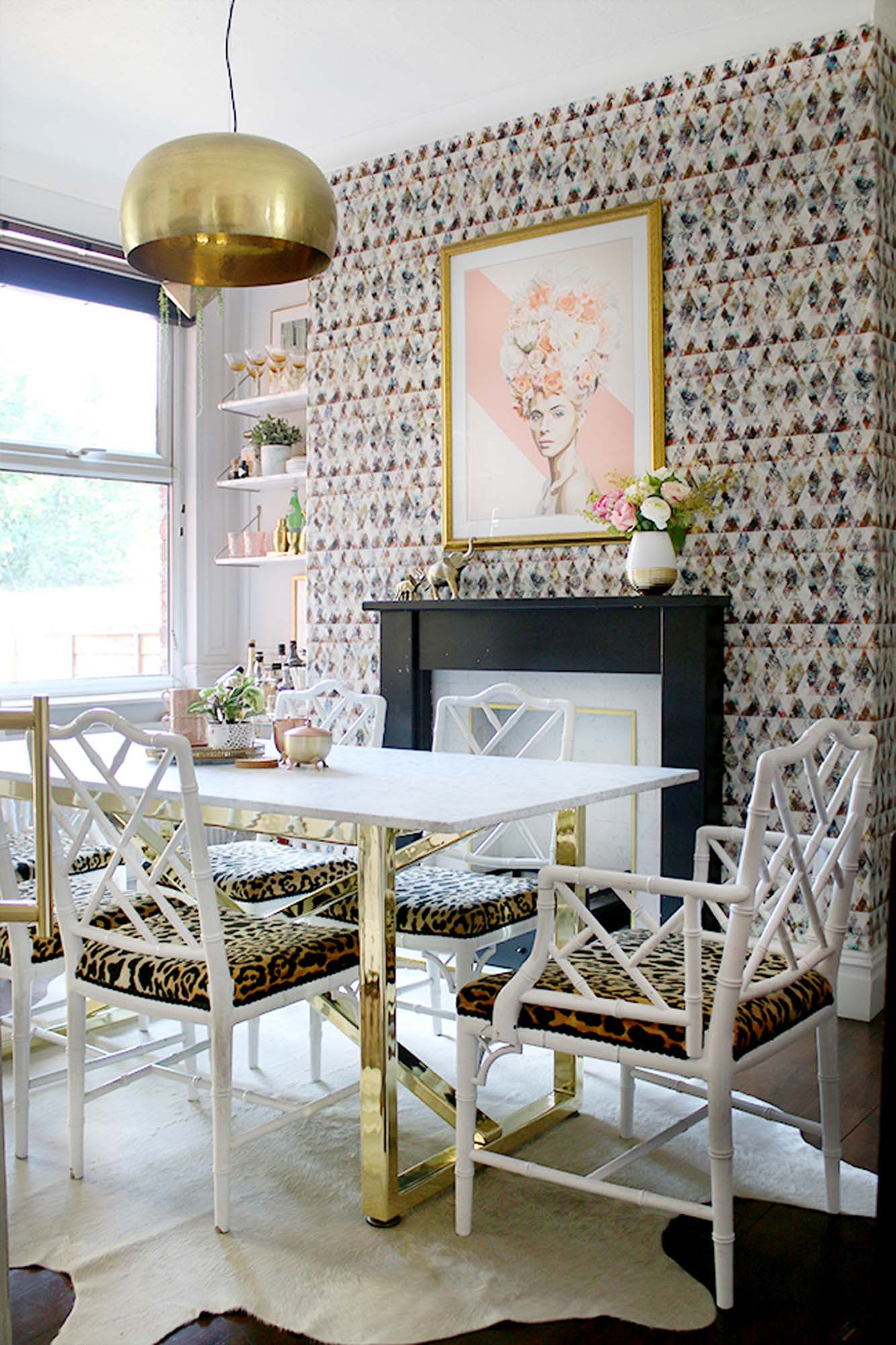 Swoon Worthy glamorous dining room with leopard print chairs