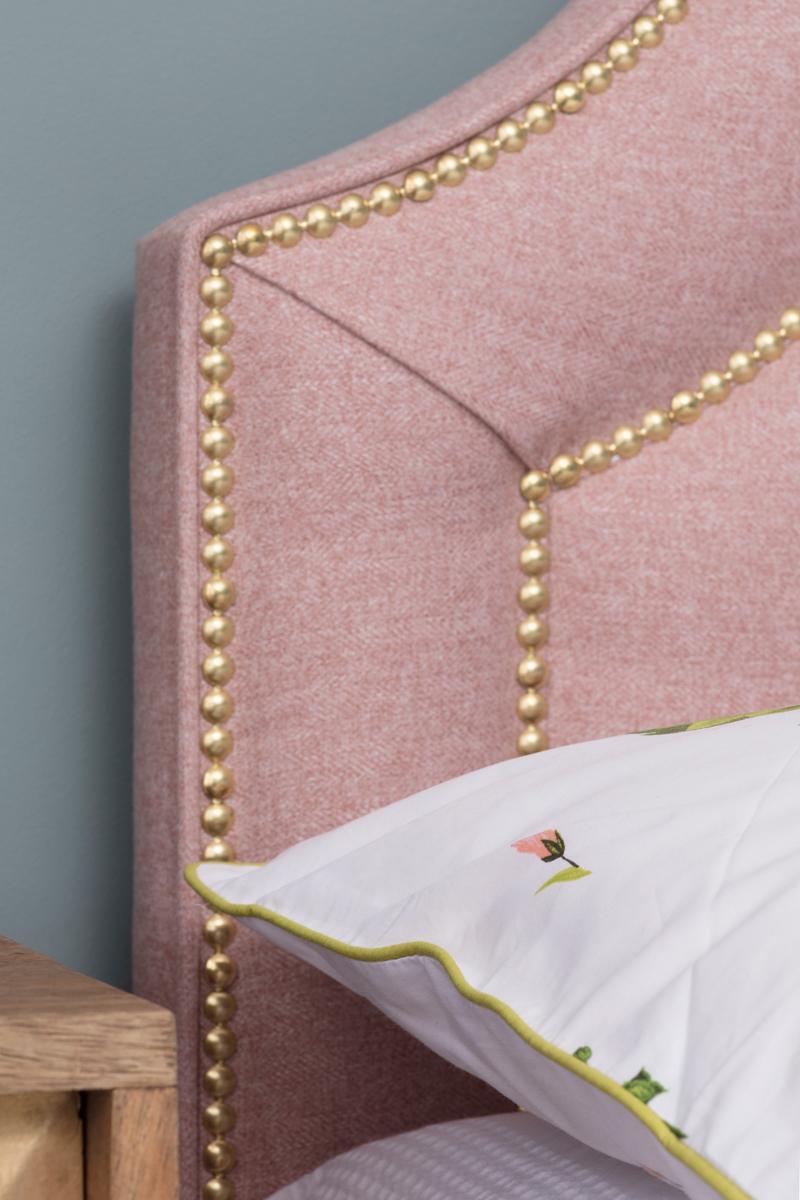 Pink and brass headboard