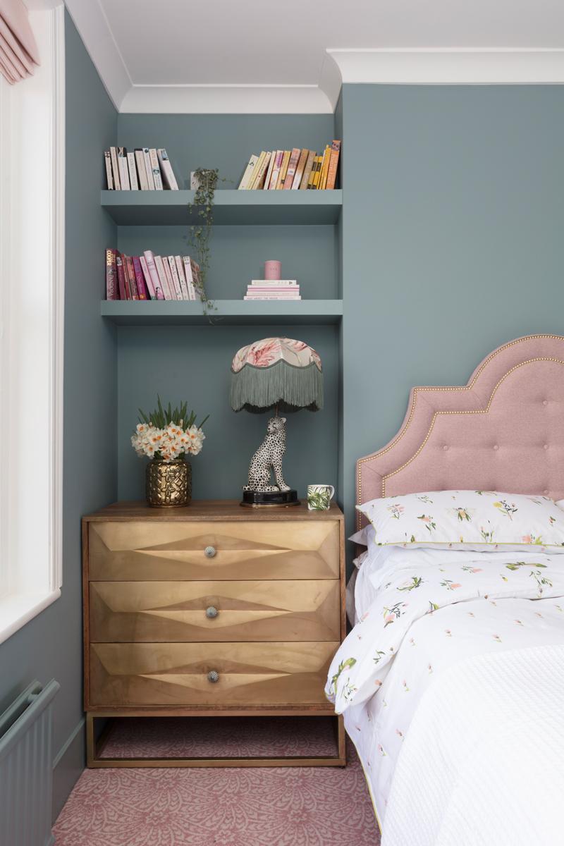 Pink headboard with Farrow & Ball oval room blue walls