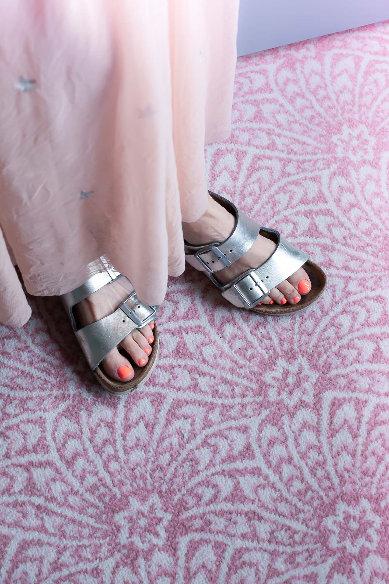 Neon nails and silver Birkenstocks
