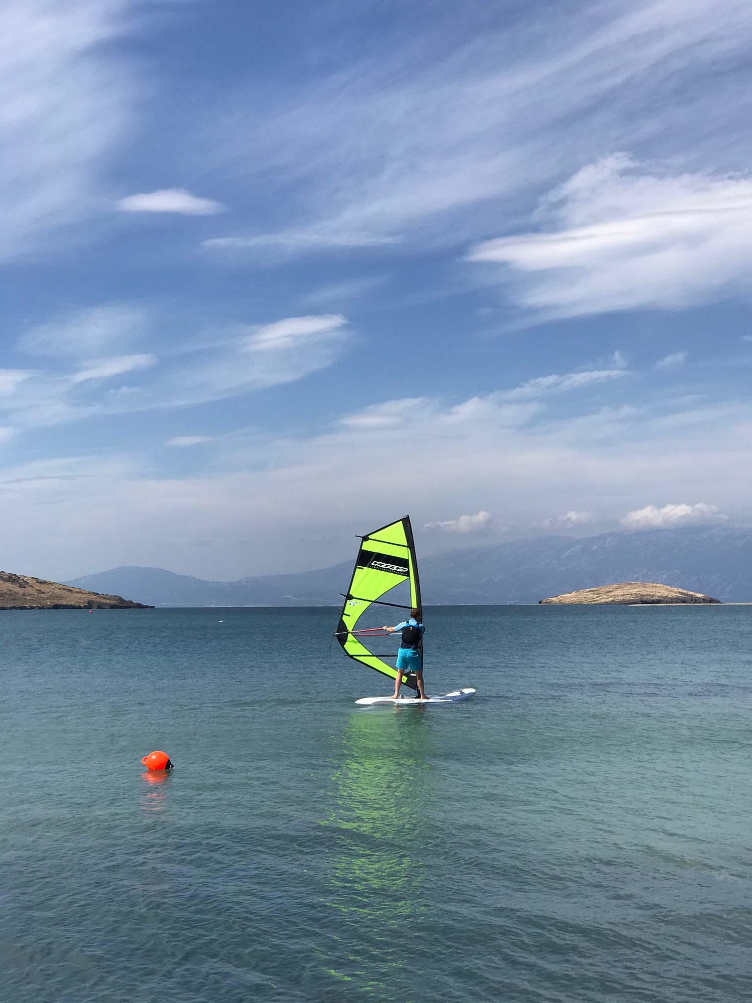 The Pink House Husband windsurfing like a boss. Before he fell off