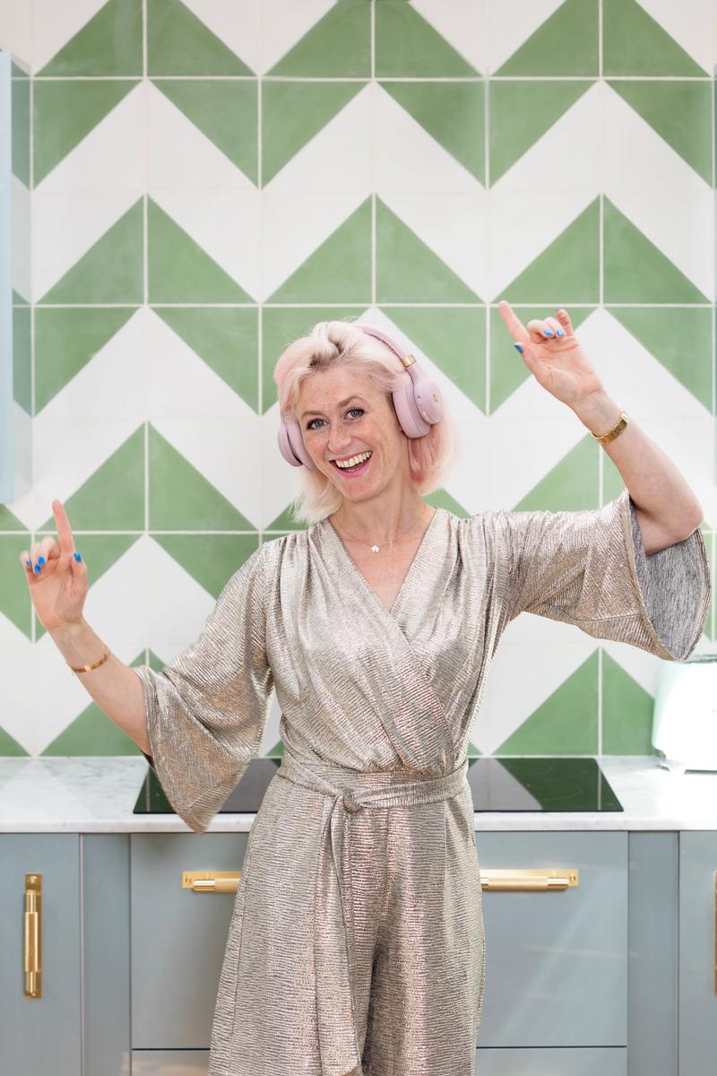 Dancing in the kitchen wearing Quincy JBL pink headphones