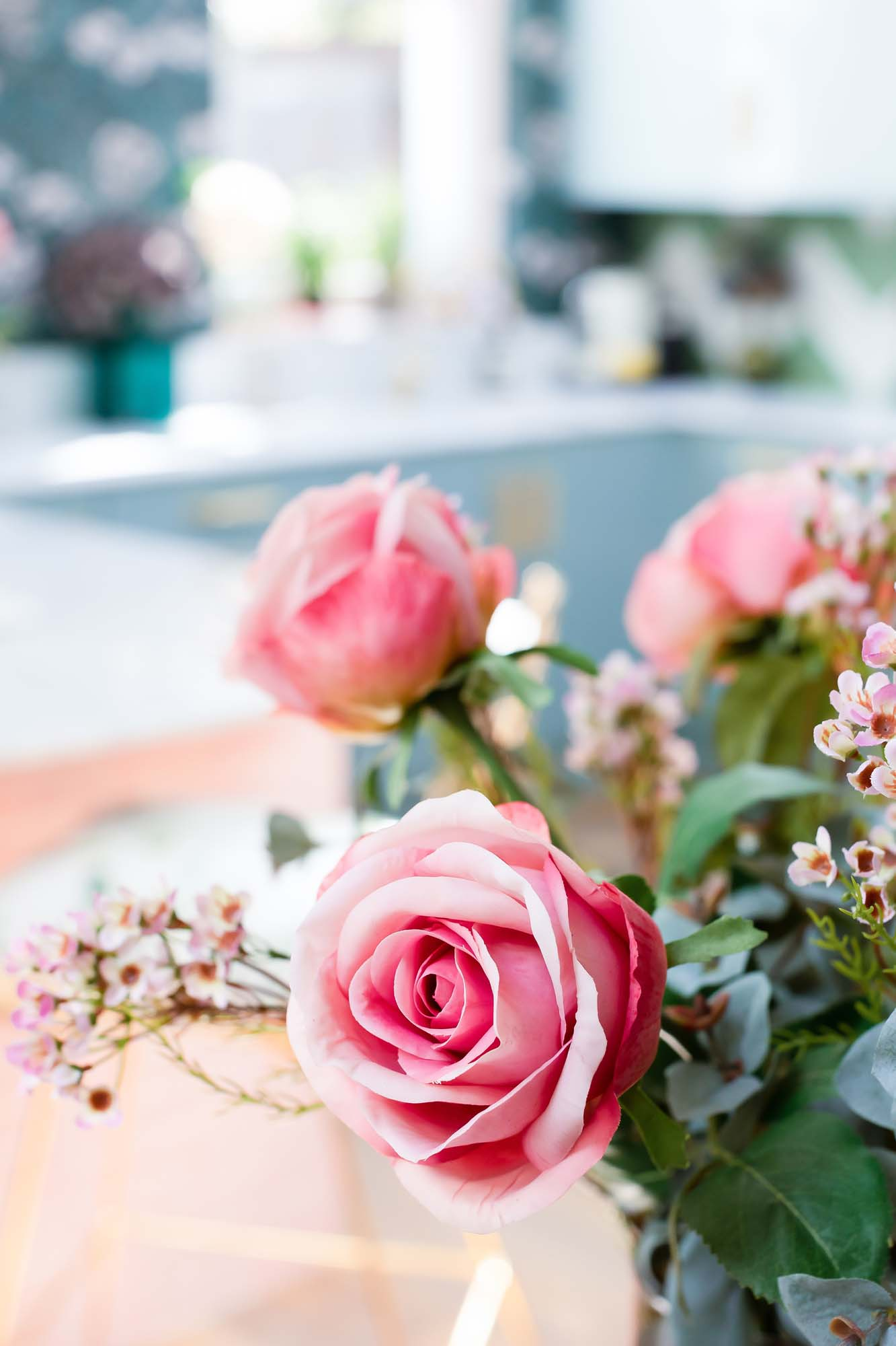 Faux  roses  and  waxflowers  | Photo: Jane Looker Photography