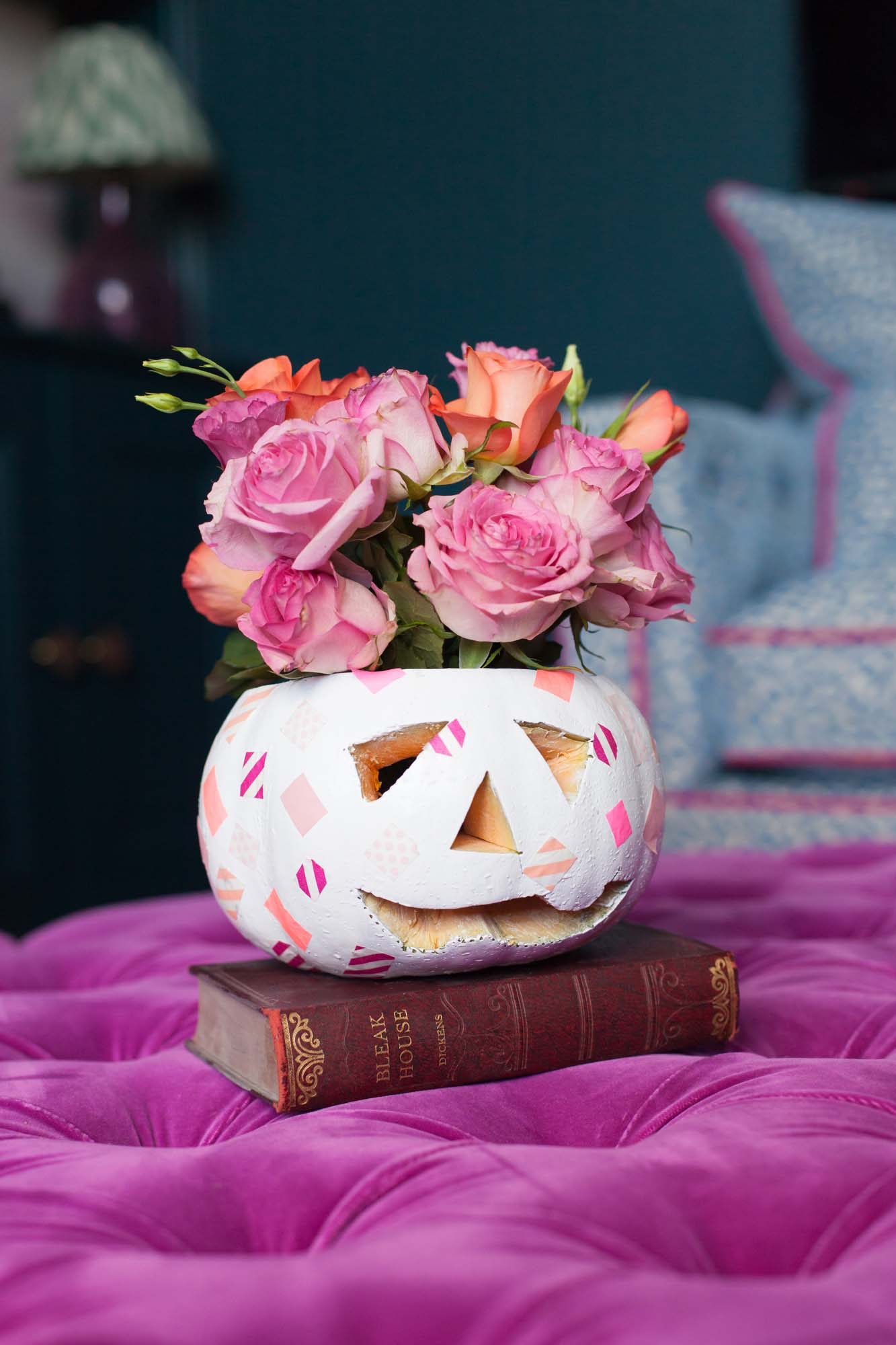 White pumpkin with pink washi tape as a flower vase