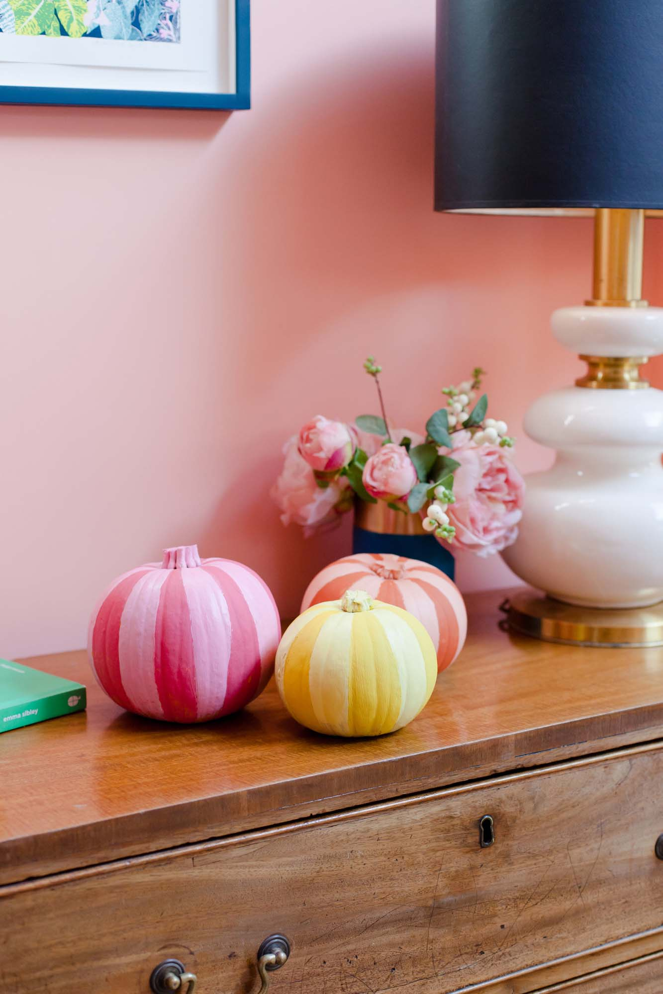 Stripy painted pumpkins in pink, orange and yellow