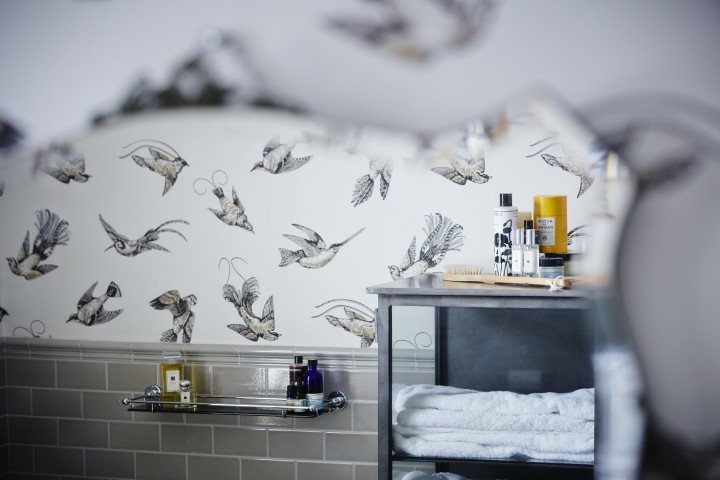 This wallpapered bathroom was designed by my talented interior designer cousin,  Eleanor Horwell