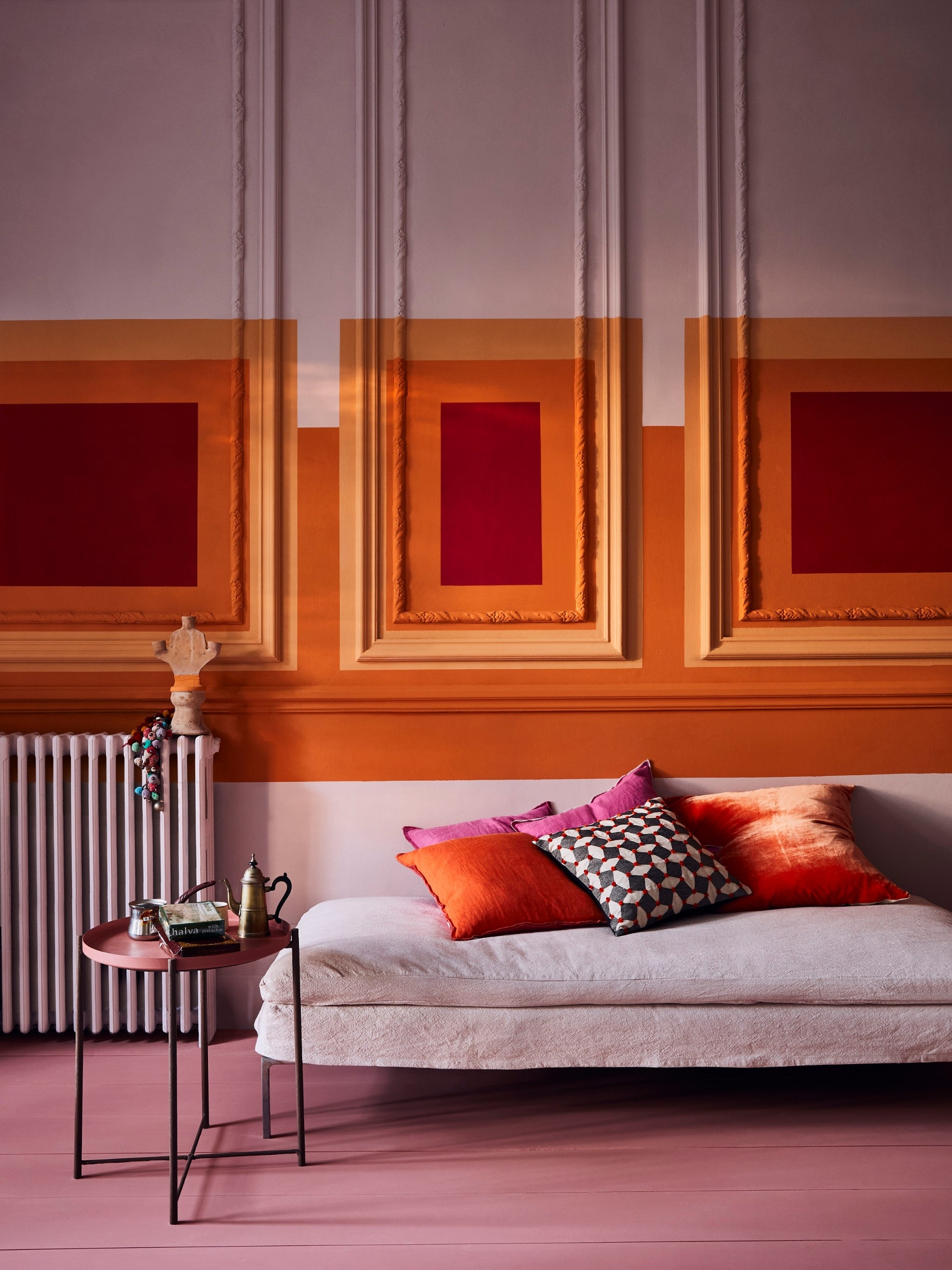 Annie Sloan recommends going all out and layering pinks with oranges (pink on walls, Antoinette; pink on floor, Scandinavian Pink - styled by Marianne Cotterill)