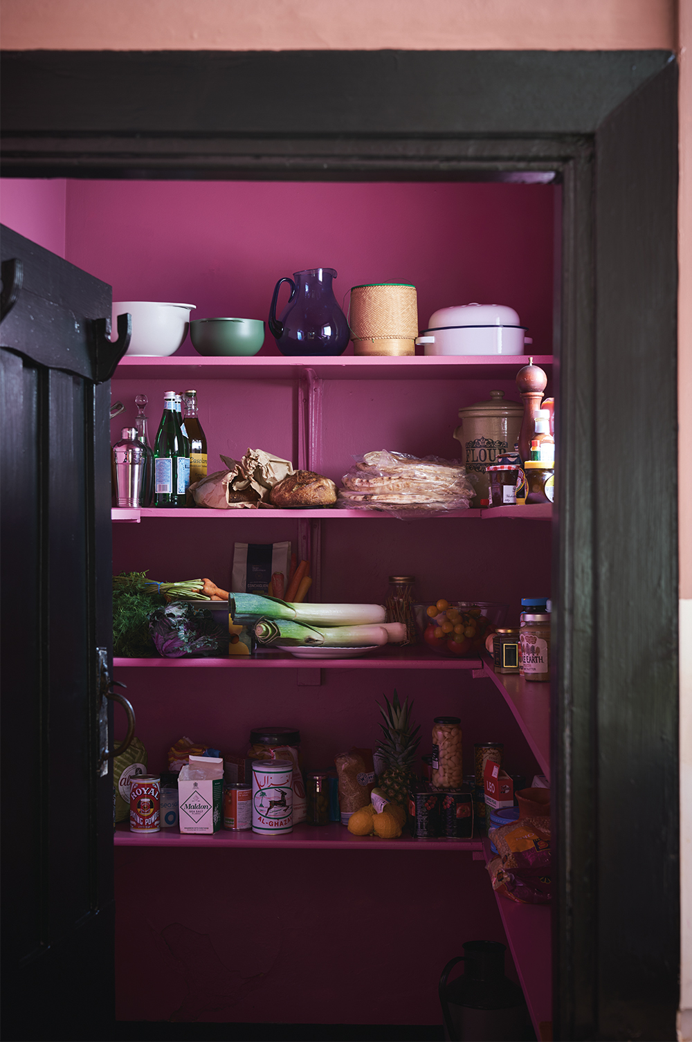 Charlotte suggests painting the inside of a bookcase or cupboard a bold pink hue for a hit of colour that isn't too in-your-face