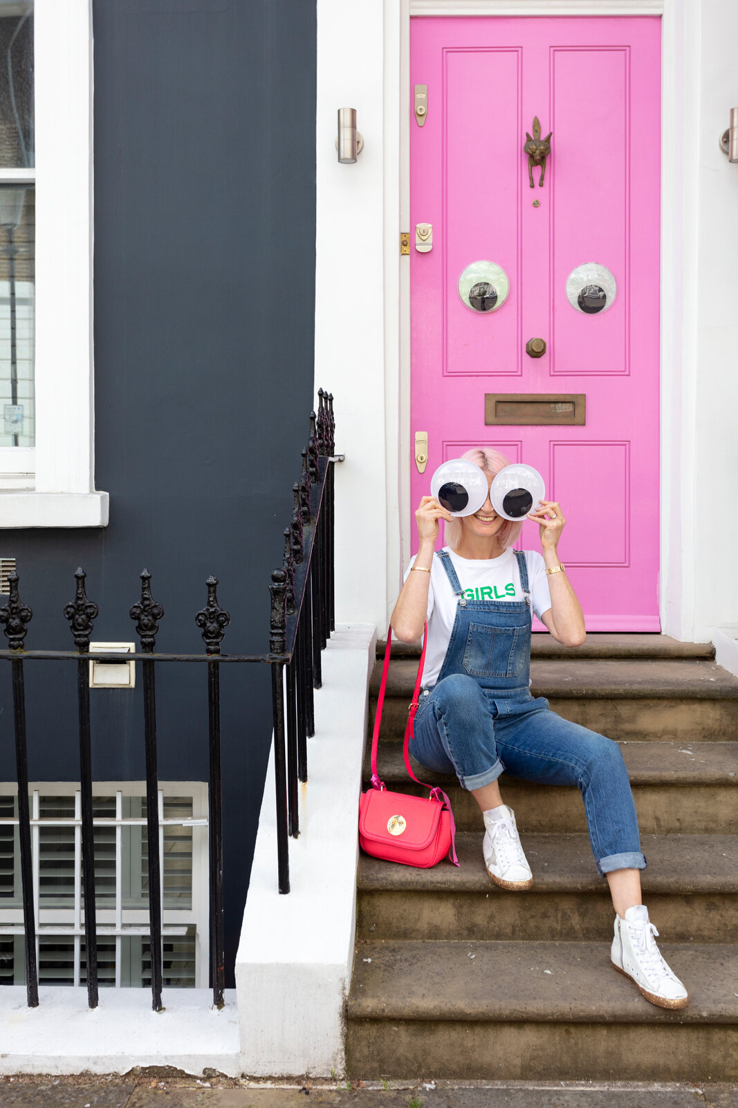 Me, my fave Hill & Friends handbag and a couple of spare googly eyes outside Emma's amazing pink door