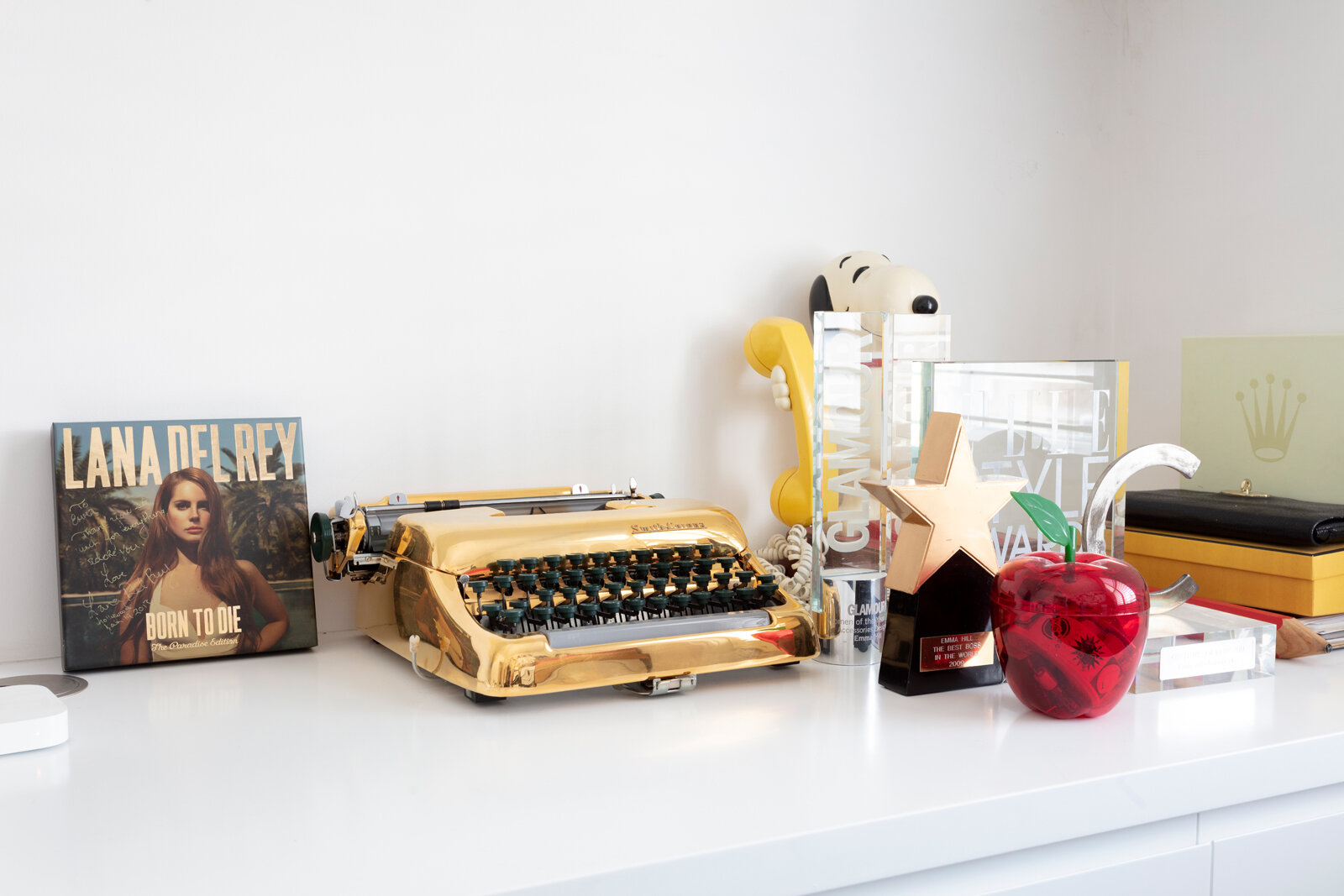 Gold typewriter and Emma Hill's collection of awards
