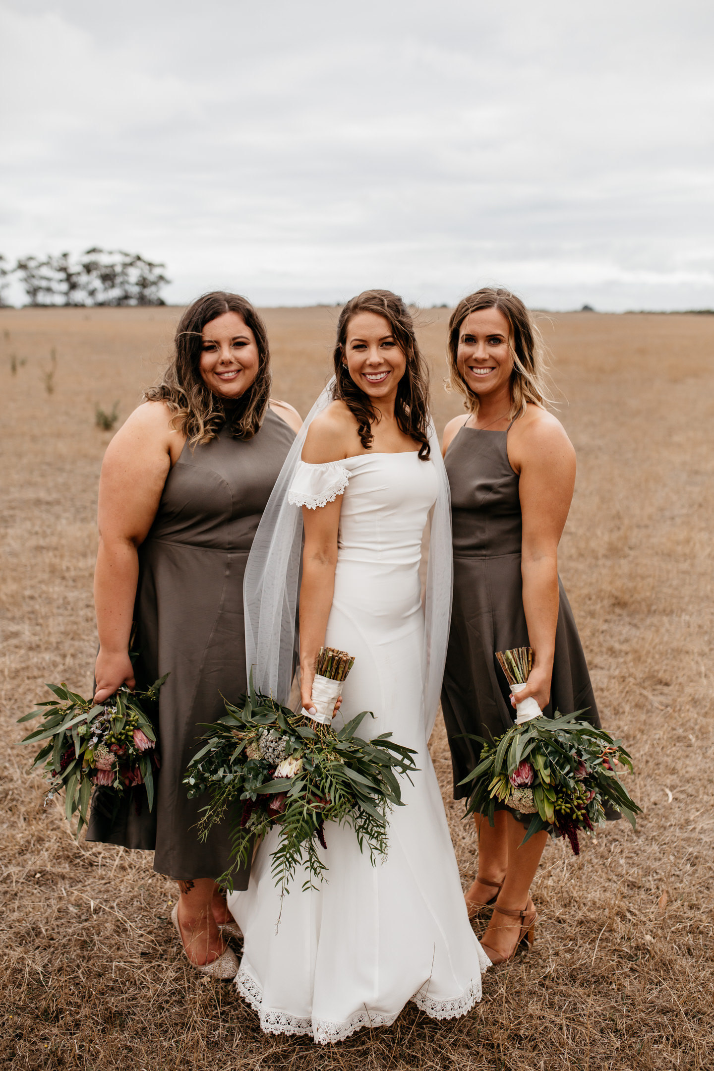 Laura and her bridesmaids in olive midi dress