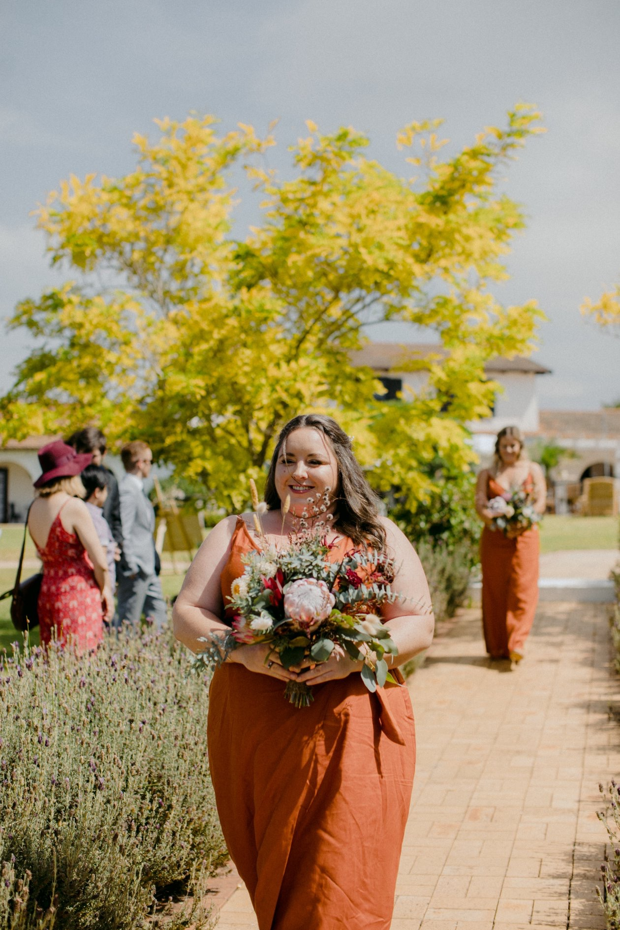 Rust coloured wrap dress for curvy bridesmaids