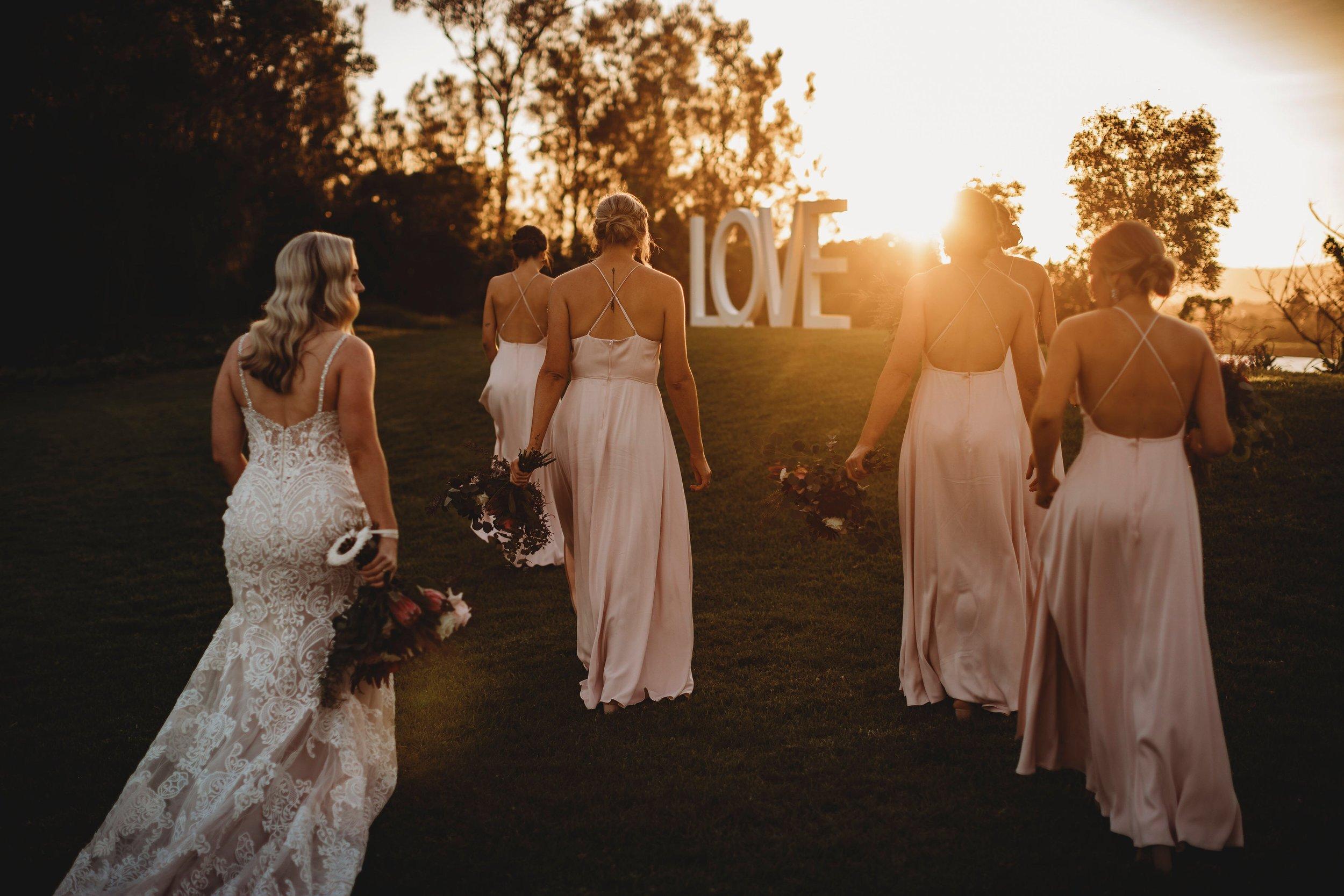 Stylish blush bridal party sunset photography