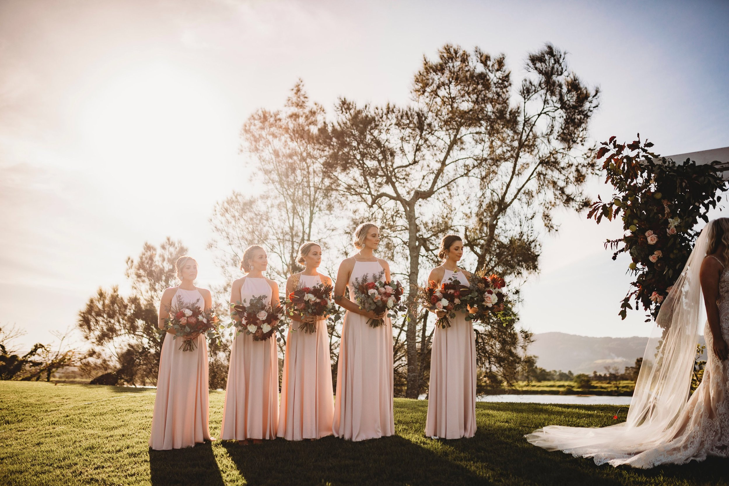 Dusty pink bridal party with native Australian flower bouquets