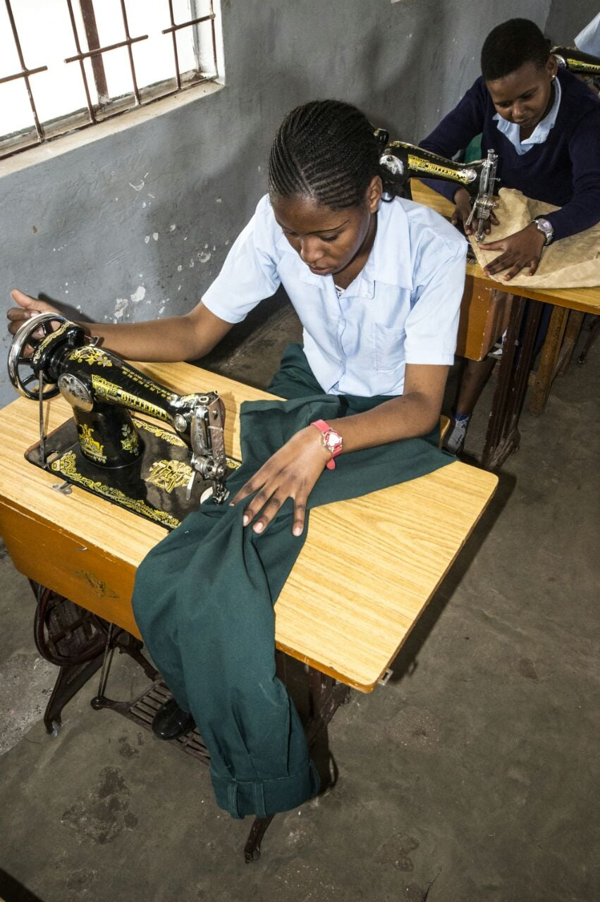 Students at the Vocational College learning to sew