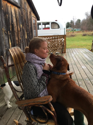 Me on the back porch at Camp Now, with my two gurus, Merlin and Willow, and Peace Bus parked out back.