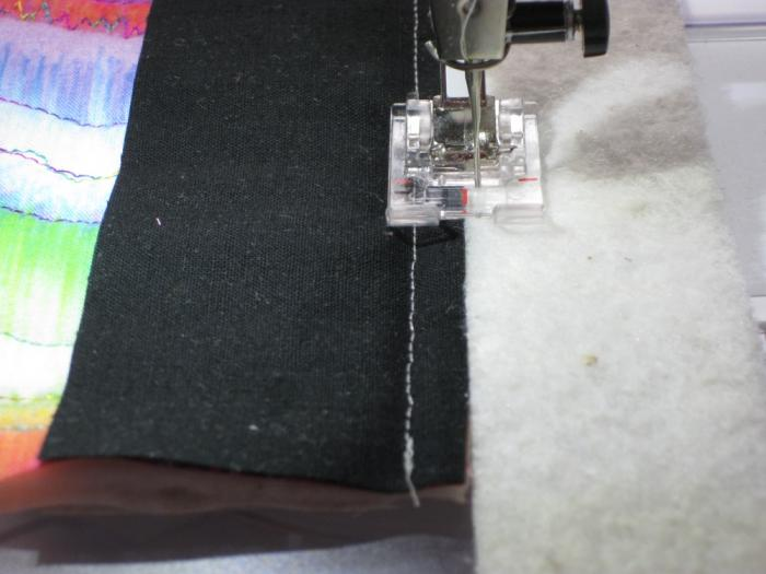 Cut batting and butt it against the old batting. Stitch with wavy/serpentine stitch. Catching b...