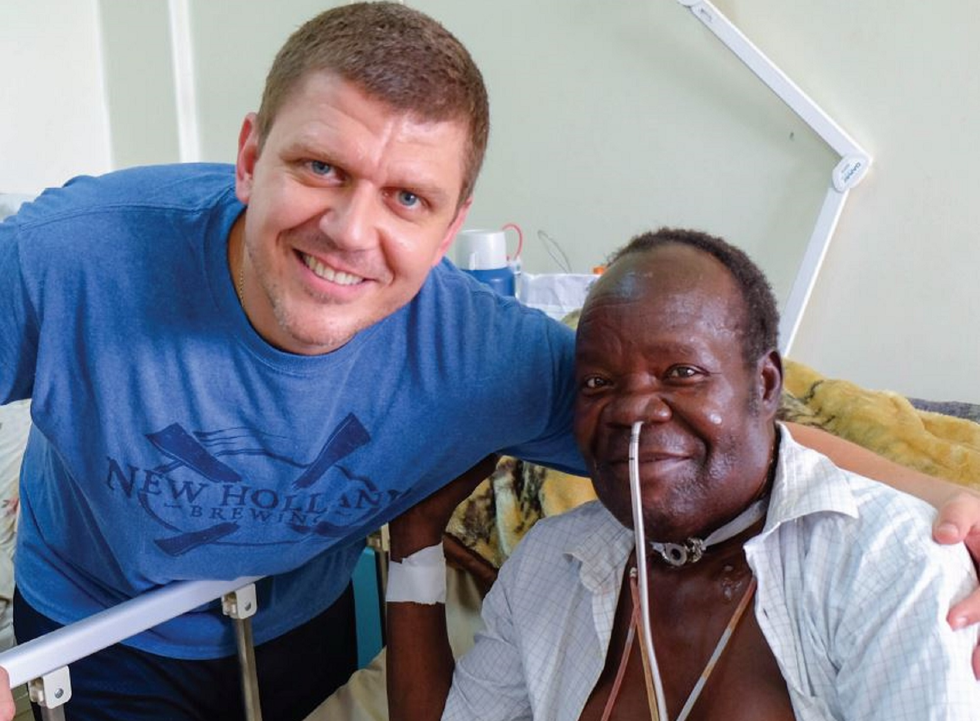 Dr. Chad Zender with headmaster David Amiye, whose total laryngectomy was performed at the Uganda Cancer Institute