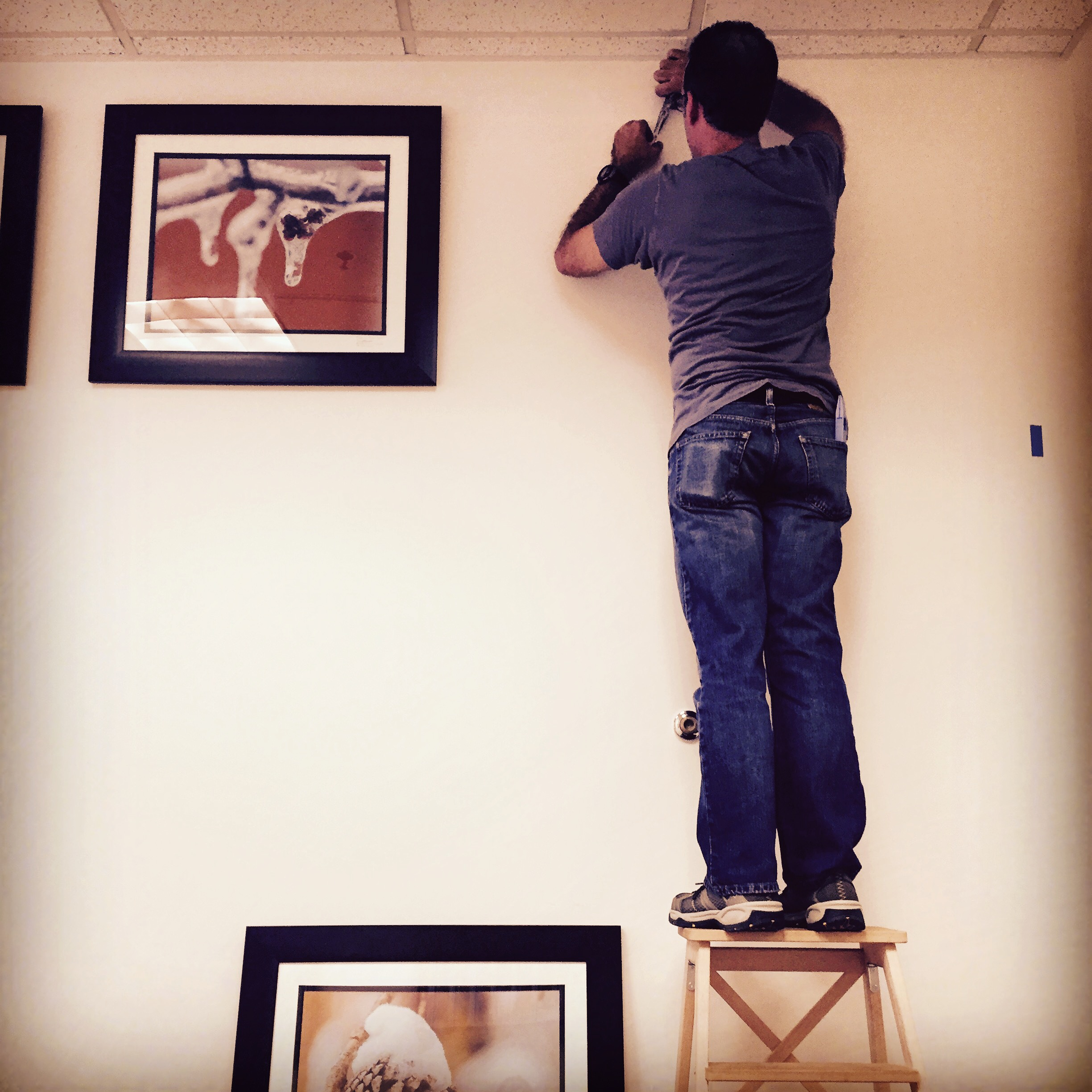 Dan hanging his work and getting ready for the opening.