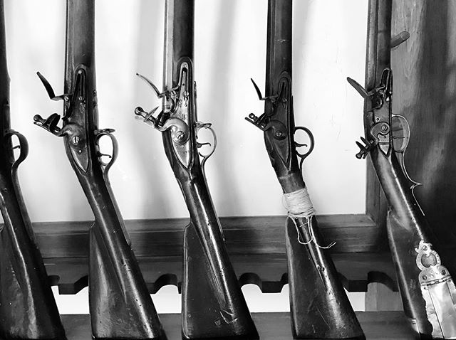 Reproduction muskets from the armory at Colonial Williamsburg.⠀ .⠀ .⠀ .⠀ #colonialwilliamsburg #muskets #guns #armory #history #travel #virginia #blackandwhitephotography