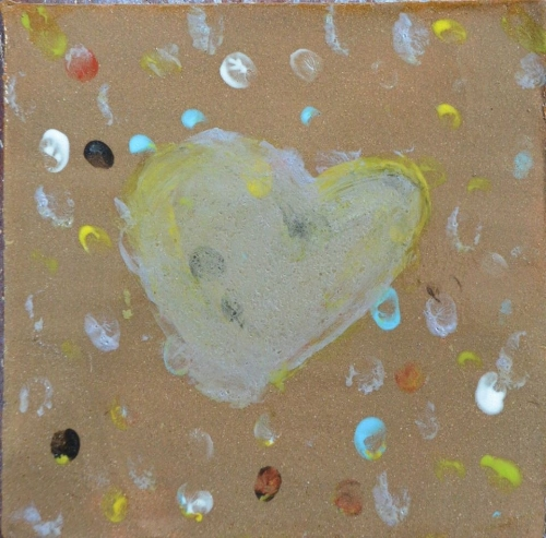 this tile was made by a couple of the giggly girls, it was even covered in glittery sprinkles...but sadly those burn away in the kiln firing