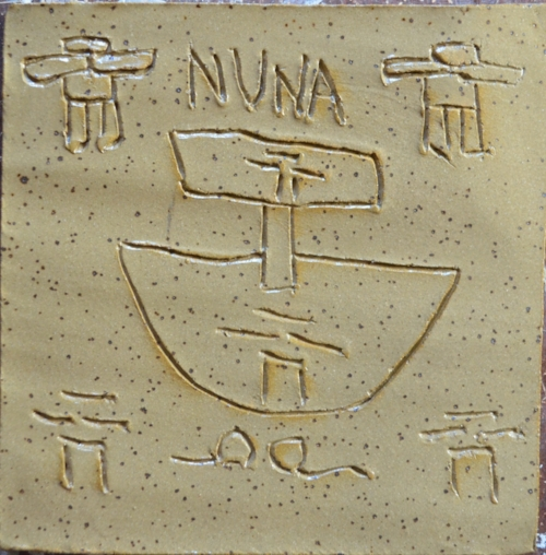 "In Inuktituk nuna, ᓄᓇ means earth, nature, land. This tile maker said ""Nuna is us. The Inuit People"""