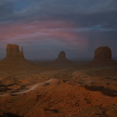 3griga_monument valley the mittens lit by fireworks.jpg