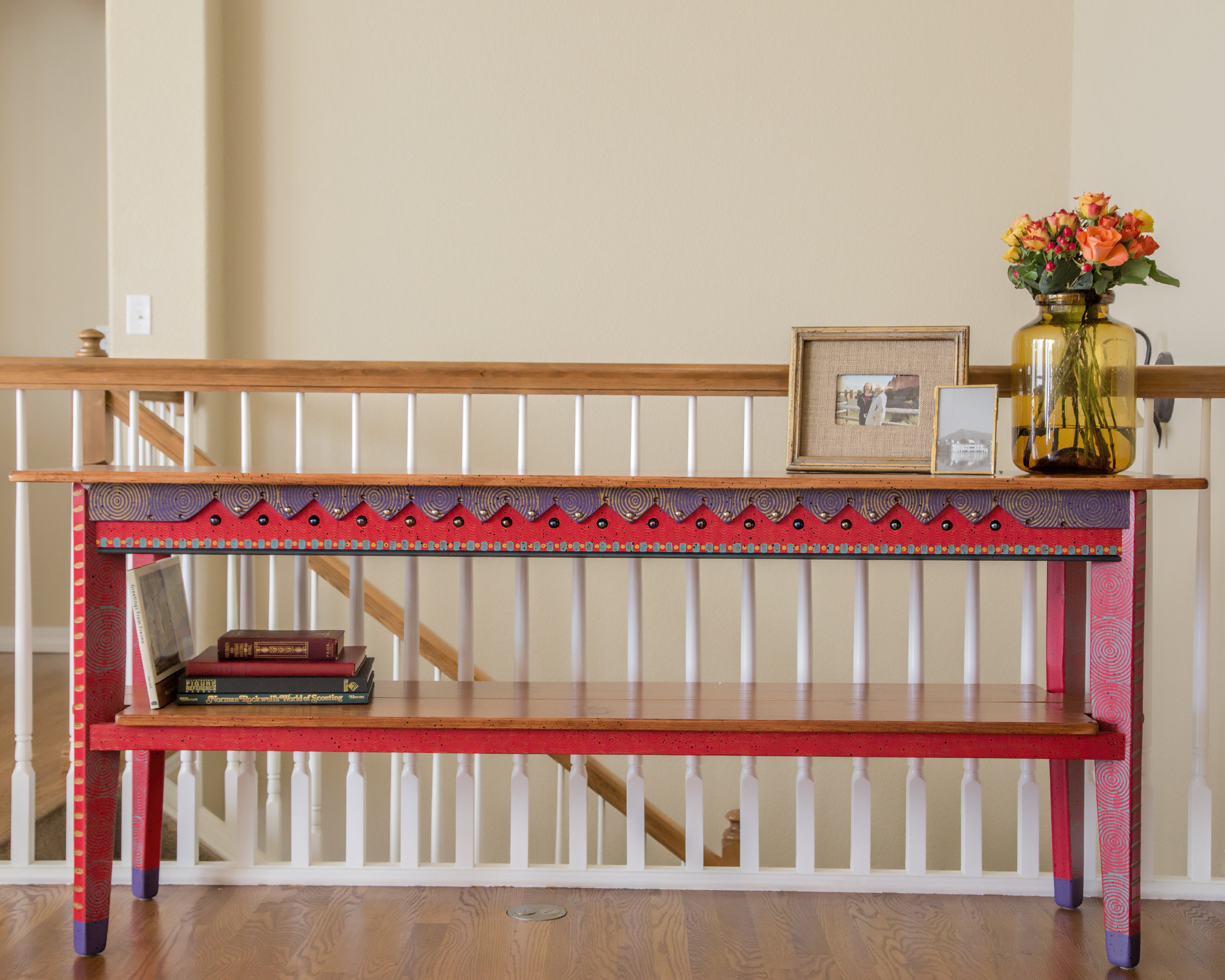 This console table matches the foyer bench. All that was needed by us was a little styling.